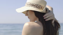 Young adult female relaxing in sea - stock footage