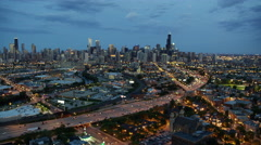 Aerial sunset view of busy metropolitan Chicago city and freeways Stock Footage