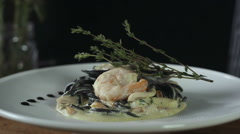 Black Spaghetti With Prawns on White Plate Complete Stock Footage