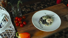 Black Spaghetti With Prawns And Seafood On White Plate Stock Footage