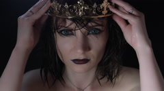 4k shoot of a horror Halloween model - Vampire putting crown on head Stock Footage
