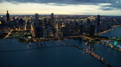 Aerial distant sunset view of Lake Michigan and Chicago skyscrapers Stock Footage