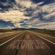 Conceptual Image of Road With the Word Accomplish Stock Photos