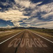 Conceptual Image of Road With the Word Courage Stock Photos