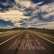 Conceptual Image of Road With the Word Miracle - stock photo