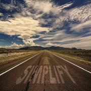 Conceptual Image of Road With the Word Simplify Stock Photos