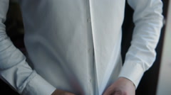 Man Buttoning White Shirt Stock Footage