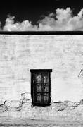 Window on an Abandoned Adobe Building Stock Photos
