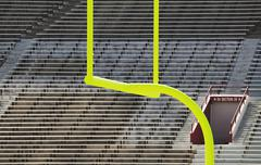Goal Posts and Empty Stands - stock photo