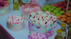 Colorful Marshmallows Candy On White Table Stock Footage