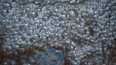 Bubbles and water splashes near the transition of the river. Slow mo, slo mo Stock Footage