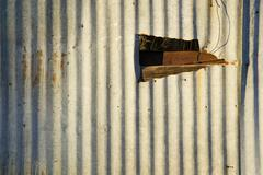 Corrugated Metal with a Hole - stock photo