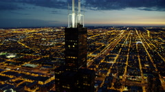 Aerial close up night view of Sears Tower and Chicago city USA Stock Footage