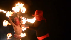 Fire show artist juggling fire in the dark Stock Footage