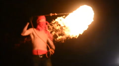 Fire show artist juggling fire in the dark Stock Footage