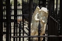Angel behind wrought iron bars Stock Photos