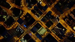 Aerial overhead night view of Chicago city freeways and skyscrapers Stock Footage