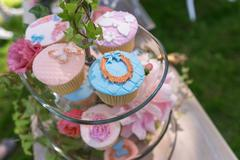 Beautiful cupcakes on a glass stand Stock Photos