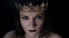 4k shoot of a horror Halloween model - Vampire with crown looking evil at camera Stock Footage