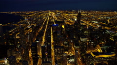 Aerial night view of Chicago city freeways and downtown skyscraper buildings Stock Footage