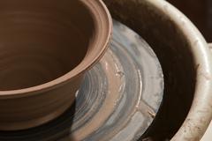 Bowl on pottery wheel Stock Photos