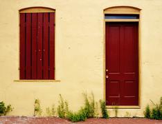 Window, Door and Weeds Stock Photos