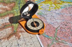 Maps and compass. Stock Photos
