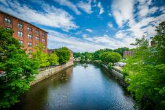 Historic brick buildings and the Cocheco River, in Dover, New Hampshire. Stock Photos