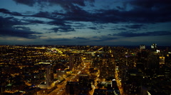 Aerial night view of urban freeways and city buildings Chicago Illinois US Stock Footage