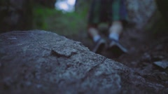 Man with backpack hiking and climbing the rocks, Ural Mountains. slow motion Stock Footage