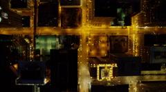 Aerial overhead illuminated night view of metropolitan city of Chicago Illinois Stock Footage