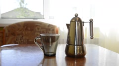 pouring the brewed coffee in a cup - stock footage