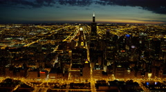 Aerial view of sun setting over Lake Michigan and Willis Tower Chicago Stock Footage