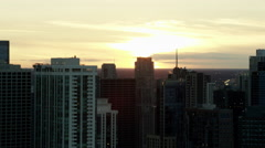 Aerial sunset silhouette of downtown skyscraper buildings Chicago USA Stock Footage