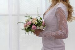 Bride in dress with flowers without the face Stock Photos