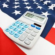 National flag with calculator over it - United States Stock Photos