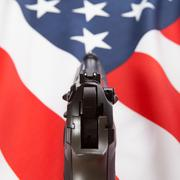 Ruffled flag with hand gun over it series - United States of America Stock Photos