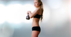Young attractive caucasian woman lifting kettlebell weight Stock Footage