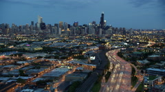 Aerial night view of Chicago city freeway traffic and skyscrapers Stock Footage