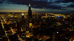 Aerial night view of city freeways and skyscrapers Chicago Illinois US Stock Footage