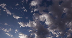4K Time-lapse of clouds moving across a blue sky - stock footage