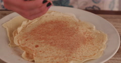 4K Close-up of Young girl rolling pancakes Stock Footage