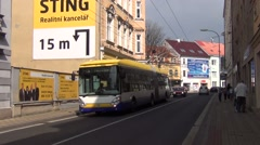 Articulated yellow and blue Arriva trolleybus runs along Rokycanova Street - stock footage