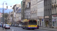 Yellow and blue Arriva trolleybus runs downhill along Masarykova trida Stock Footage
