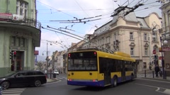 Yellow and blue Arriva trolleybus turns to Masarykova trida from Skolni Street Stock Footage