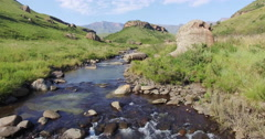 4K aerial view of a river in the Drakensburg mountains Stock Footage