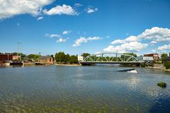 Bridge across the pond in the park Stock Photos