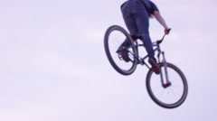 Extreme Mountain Bike 360 on dirt jump Stock Footage