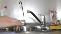 Washing dishes in the sink using detergent Stock Footage