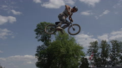 Extreme sport BMX crash on dirt jump - broken ankle Stock Footage